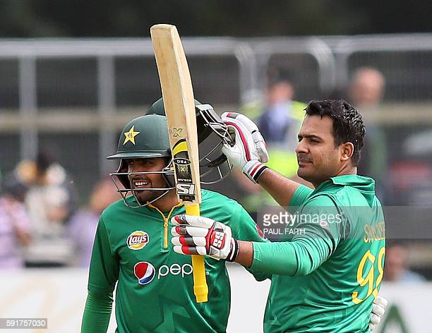 Pakistan's Sharjeel Khan celebrates with team mate Babar Azam after making a century during the first one day international cricket match between...