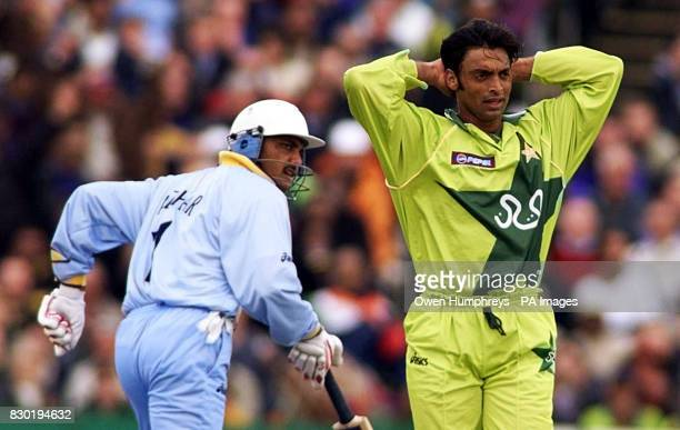 Pakistan's Shoaib Akhtar holds is head in his hands after being hit to the boundary by India captain Mohammad Azharuddin during the Super Six Cricket...