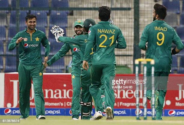 Pakistan's Shoaib Malik celebrates with his teammates after catching out West Indies' Kieron Pollard during the 3rd ODI cricket match between...
