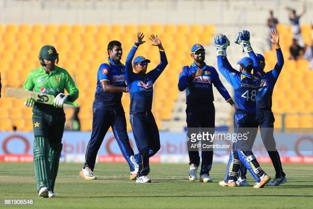 TOPSHOT Pakistan's Shoaib Malik leaves the field after being dismissed by Sri Lank's Nickwella Dickwella during the second one day international...
