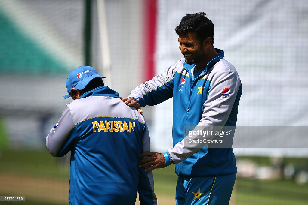 Pakistan's Sohail Khan laughs with coach Mushtaq Ahmed during the England and Pakistan nets session at The Kia Oval on August 10 2016 in London...