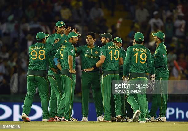 Pakistan's team celebrates after the dismissal of New Zealand's Martin Guptill during the World T20 cricket match between New Zealand and Pakistan at...