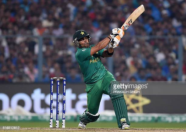 Pakistan's Umar Akmal plays a shot during the World T20 cricket tournament match between India and Pakistan at the Eden Gardens cricket stadium in...