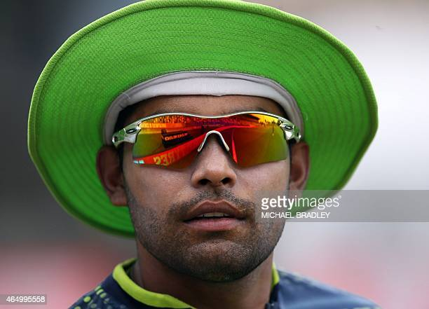 Pakistan's Umar Akmal takes part in a training session ahead of their 2015 Cricket World Cup Group B match against United Arab Emirates in Napier on...