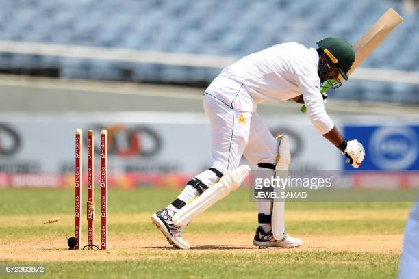 Pakistan's Wahab Riaz is bowled off West Indies' bowler Alzarri Joseph on day four of the first Test match between West Indies and Pakistan at the...