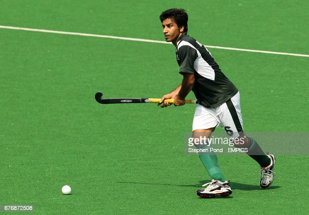 Pakistan's Waseem Ahmad in action against Scotland during day two of the 2010 Commonwealth Games at the Major Dhyan Chand National Stadium in Delhi...