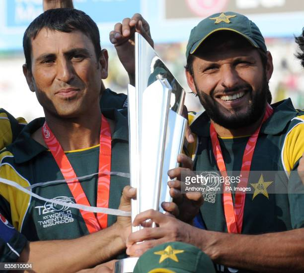 Pakistan's Younis Khan and Shahid Afridi hold the world cup trophy after Pakistan beat Sri Lanka during the Final of the ICC World Twenty20 at Lords...