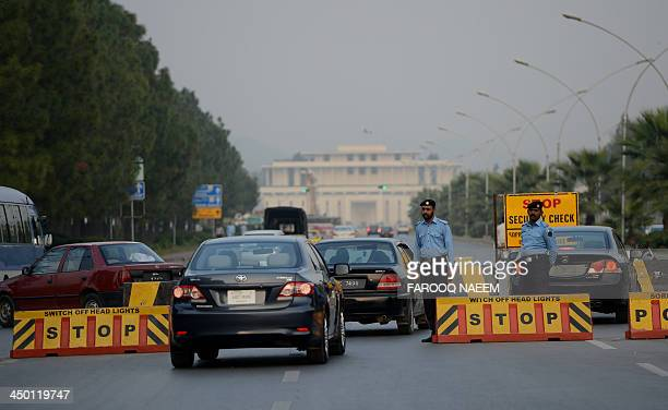 Pakistanunrestcrimeextortion TalibanFEATURE by Gohar ABBAS Pakistani policemen inspect vehicles at a checkpoint on the capital's constitution avenue...