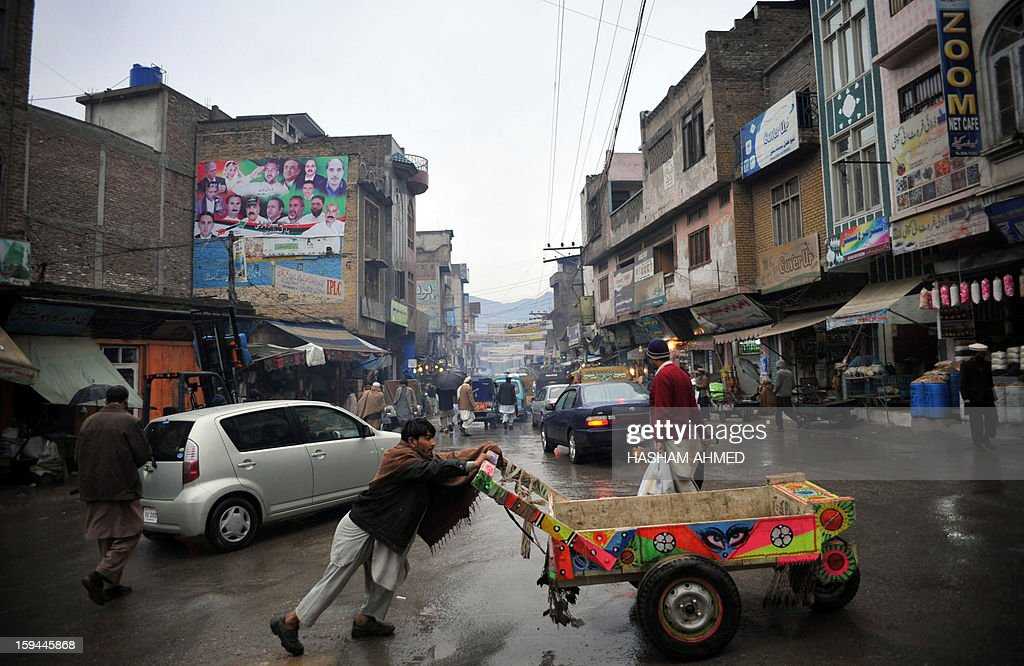 Pakistan-unrest-northwest,FOCUS by Sajjad Tarakzai In this photograph taken on January 12, 2013, a Pakistani labourer pushes a cart down a main street in Mingora, the main town of Swat Valley. The worst bomb attack in years has fuelled growing fears of a Taliban comeback in Pakistan's Swat valley, where schoolgirl rights activist Malala Yousafzai was shot in the head last October.