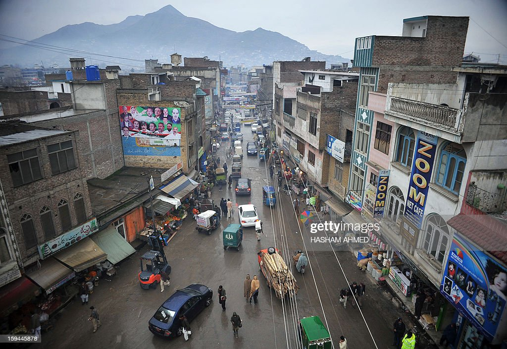 Pakistan-unrest-northwest,FOCUS by Sajjad Tarakzai In this photograph taken on January 12, 2013, Pakistani pedestrians and cars travel down a main street in Mingora, the main town of Swat Valley. The worst bomb attack in years has fuelled growing fears of a Taliban comeback in Pakistan's Swat valley, where schoolgirl rights activist Malala Yousafzai was shot in the head last October.