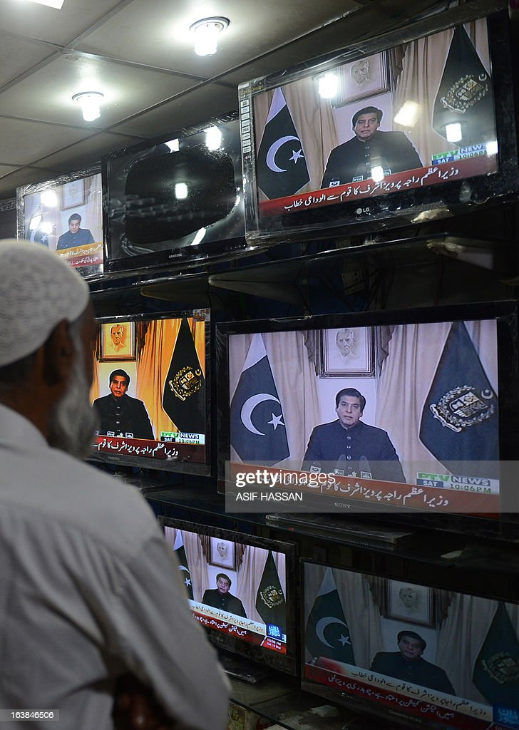 Pakistan-unrest-vote-government,FOCUS by Sami Zubeiri Pakistanis listen to Pakistani Prime Minister Raja Pervez Ashraf's address to the nation on national television at a shop in commercial center in Karachi on March 16, 2013. Pakistan's parliament has become the first in history to complete a full term in office, but a raft of key achievements have been overshadowed by mismanagement, economic decline and worsening security.