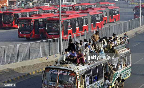 PakistanunrestvotepoliticsdevelopmenteducationFOCUS by Khurram Shahzad In this photograph taken on June 5 shows Pakistani commuters travelling on a...