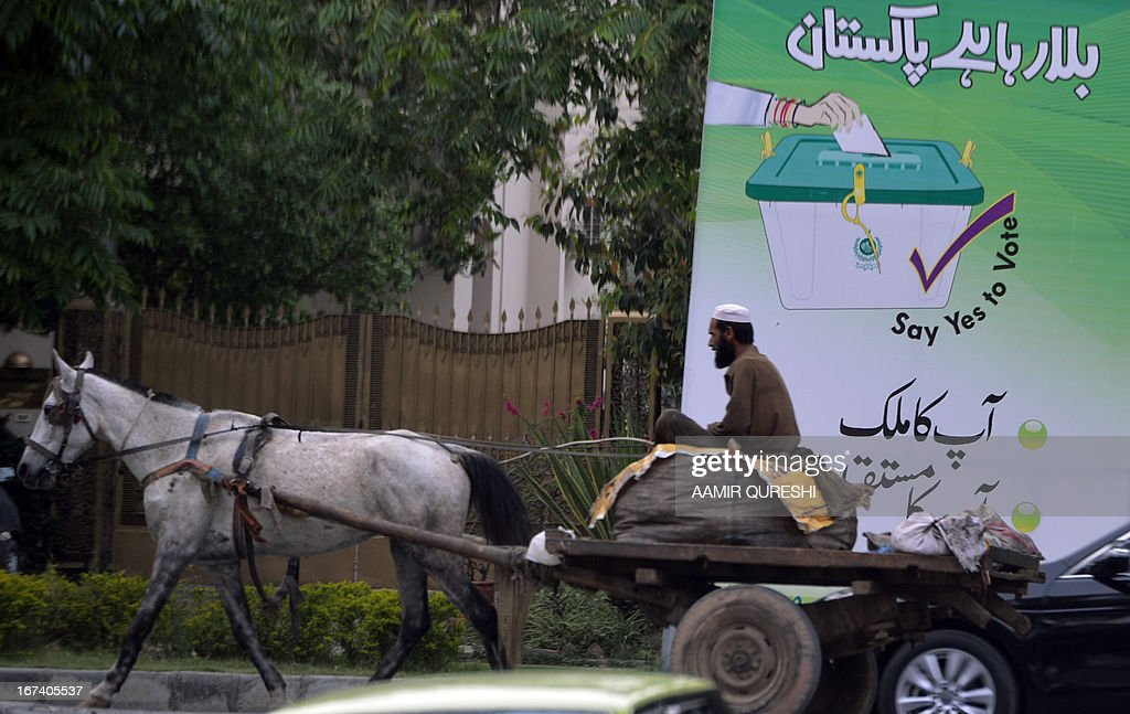 WITH Pakistan-unrest-vote-politics-women, FOCUS by Sami Zubeiri A horse-driven cart passes by an electoral billboard with the message 'Pakistan is calling, your country your future,' in the Pakistani capital Islamabad, on April 24, 2013. Next month's elections should mark the first democratic transition of power in Pakistan, but Taliban threats, social taboos and poor organisation will deprive millions of women their right to vote.There are more than 85 million registered voters for May 11 -- 37 million women and 48 million men -- in a country ruled by generals for half its life and where military coups have repeatedly interrupted democracy. AFP PHOTO/Aamir QURESHI
