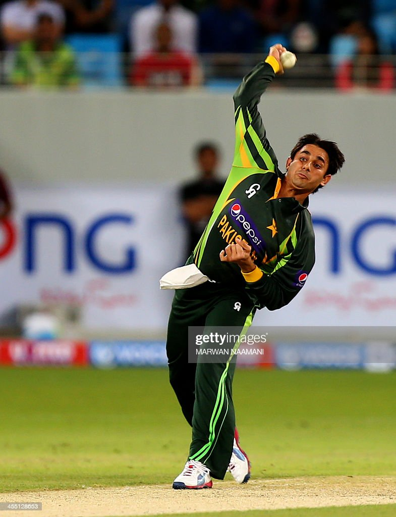 Paksitan's bowler Saeed Ajmal bowls towards Kumar Sangakkara of Sri Lanka during their first T20 match in Dubai on December 11, 2013. Angelo Mathews scored his second fifty to guide Sri Lanka to 145-5 in the first Twenty20 international against Pakistan. AFP PHOTO/MARWAN NAAMANI