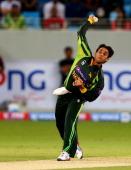 Paksitan's bowler Saeed Ajmal bowls towards Kumar Sangakkara of Sri Lanka during their first T20 match in Dubai on December 11 2013 Angelo Mathews...