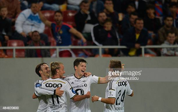 Pal Andre Helland of Rosenborg BK celebrates after he scored 20 with his teammates during the UEFA Europa League playoff football match between...