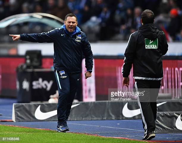 Pal Dardai head coach of Berlin shouts at the fourth official during the Bundesliga match between Hertha BSC and VfL Wolfsburg at Olympiastadion on...
