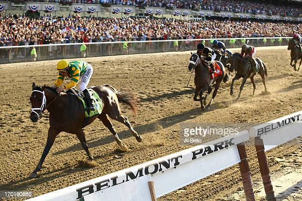 Palace Malice ridden by Mike Smith wins the 145th running of the Belmont Stakes followed by Oxbow and orb at Belmont Park on June 8 2013 in Elmont...