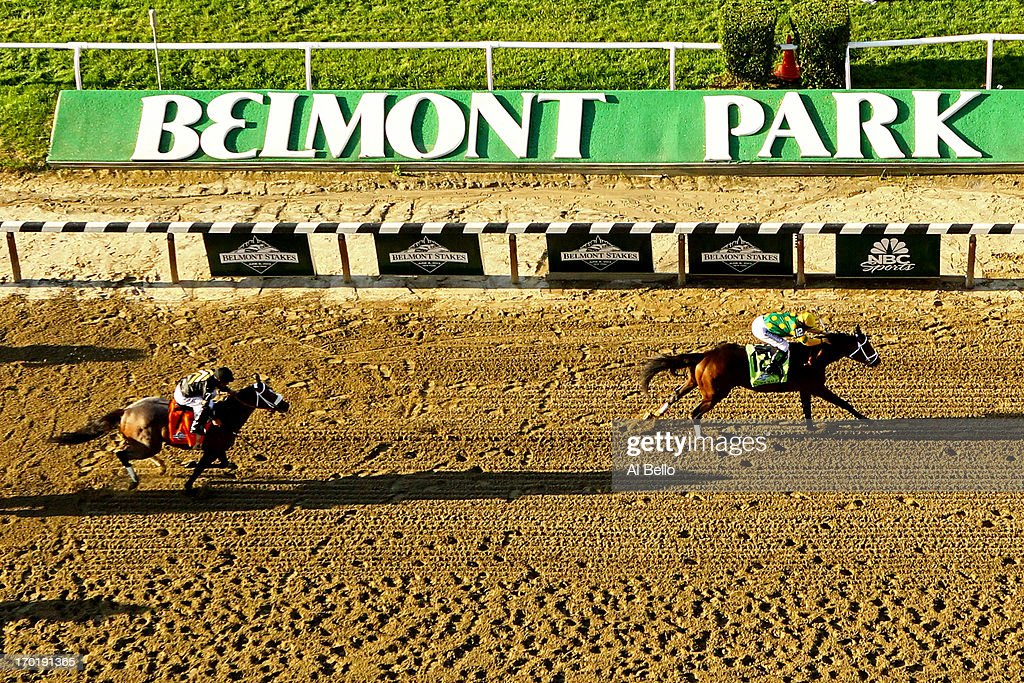 Palace Malice #12 ridden by Mike Smith wins the 145th running of the Belmont Stakes followed by Oxbow #7 Ridden by <a gi-track='captionPersonalityLinkClicked' href=/galleries/search?phrase=Gary+Stevens+-+Jockey&family=editorial&specificpeople=15617910 ng-click='$event.stopPropagation()'>Gary Stevens</a> and and Orb #5 ridden by <a gi-track='captionPersonalityLinkClicked' href=/galleries/search?phrase=Joel+Rosario&family=editorial&specificpeople=6495860 ng-click='$event.stopPropagation()'>Joel Rosario</a> at Belmont Park on June 8, 2013 in Elmont, New York.