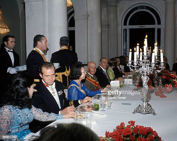 Palace Oriente Madrid Formal dinner in honor of Hector Campora with Francisco Franco and the prince of Spain Juan Carlos of Borbon