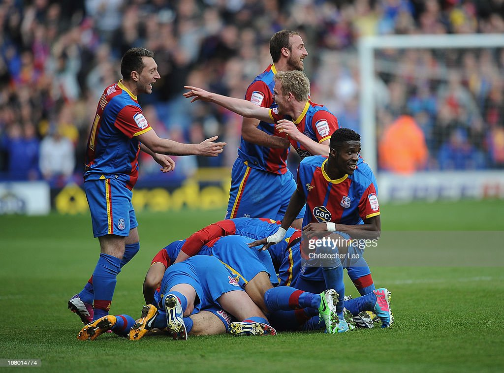 Palace players celebrate their second goal scored by Kevin Phillips as they all jump on top of him during the npower Championship match between Crystal Palace and Peterborough United at Selhurst Park on May 04, 2013 in London, England.