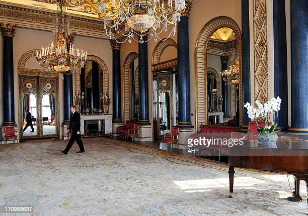 WEBSITES Palace Steward Nigel McEvoy walks through the Music Room which will be used during the wedding reception of Prince William and Kate...