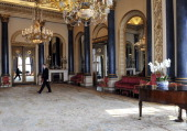 Palace Steward Nigel McEvoy walks through the Music Room which will be used during the wedding reception of Prince William and Kate Middleton at...