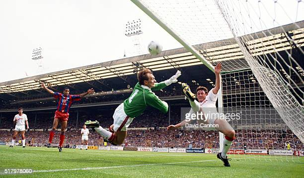 Palace striker Mark Bright celebrates as Manchester United goalkeeper Jim Leighton and defender Steve Bruce fail to keep out the first Crystal Palace...