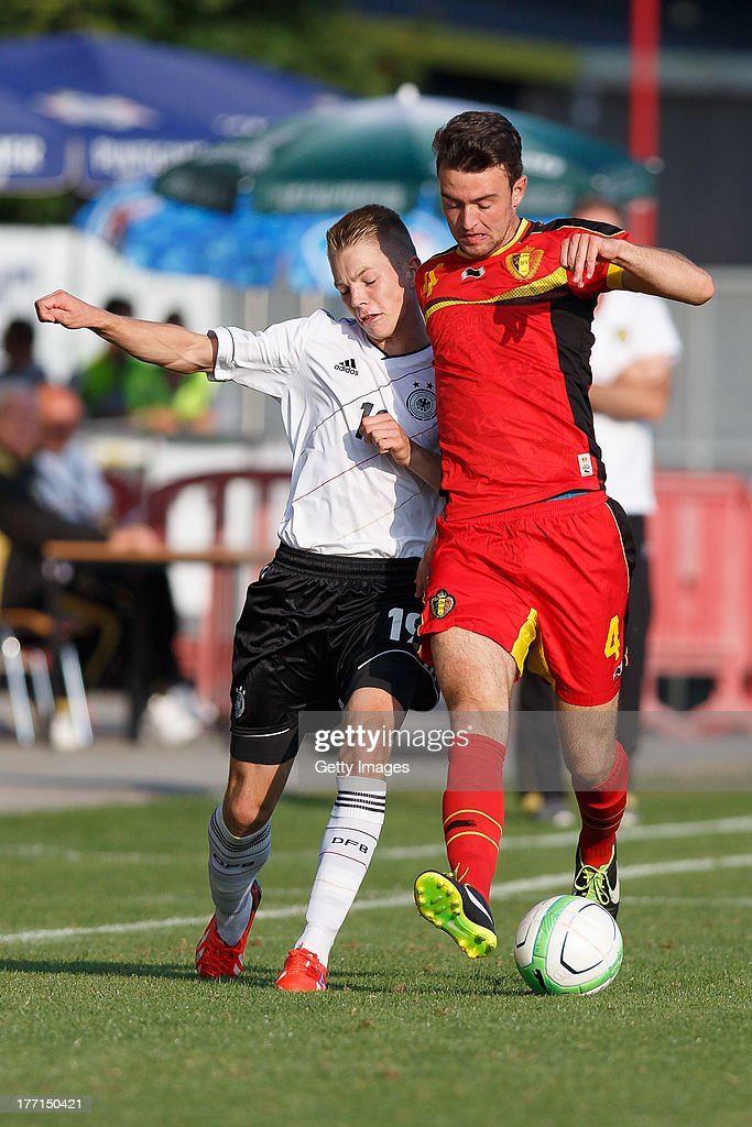 Palacios-Martinez Frederico of Germany and Wouters Dries of Belgium compete for the ball during the U17 Toto-Cup match between Germany and Belgium on August 21, 2013 in Gleisdorf, Austria.