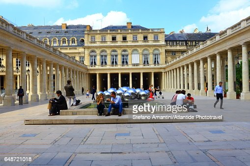 Palais Royal, Cour (courtyard) d'Honneur, people near the Sphérades or Fontaines (fountains) de Pol Bury : Stock Photo