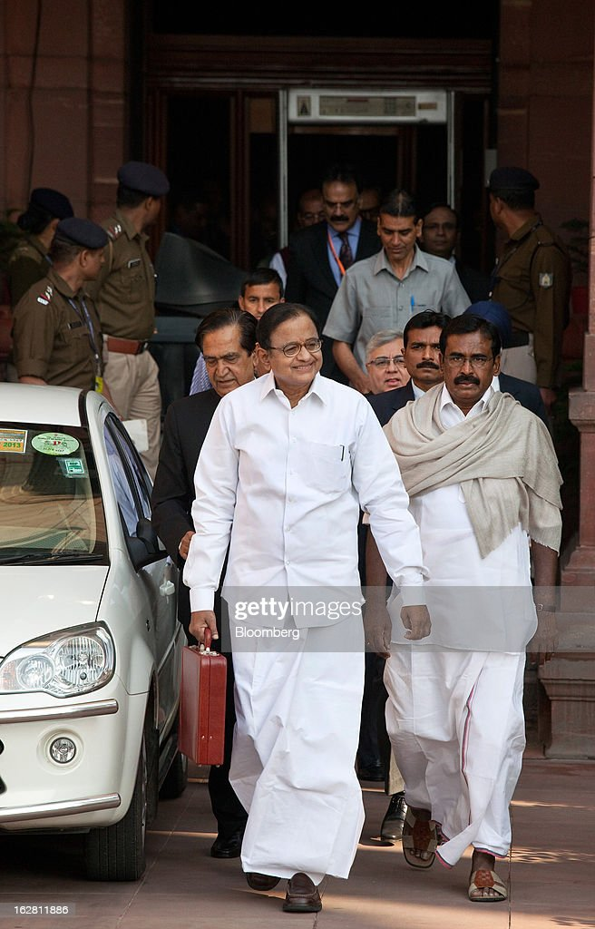 <a gi-track='captionPersonalityLinkClicked' href=/galleries/search?phrase=Palaniappan+Chidambaram&family=editorial&specificpeople=5611200 ng-click='$event.stopPropagation()'>Palaniappan Chidambaram</a>, India's finance minister, center, leaves the ministry of finance with his team to present the annual budget at the Indian Parliament in New Delhi, India, on Thursday, Feb. 28, 2013. India will spend 658.7 billion rupees on education in the financial year 2013-2014, 17% higher than the previous year, Chidambaram says in a speech today to unveil the government's budget for the year starting April 1. Photographer: Graham Crouch/Bloomberg via Getty Images