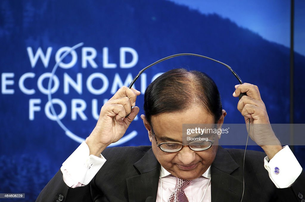 <a gi-track='captionPersonalityLinkClicked' href=/galleries/search?phrase=Palaniappan+Chidambaram&family=editorial&specificpeople=5611200 ng-click='$event.stopPropagation()'>Palaniappan Chidambaram</a>, India's finance minister, removes his headphones after listening to a speaker during a session on day two of the World Economic Forum (WEF) in Davos, Switzerland, on Thursday, Jan. 23, 2014. World leaders, influential executives, bankers and policy makers attend the 44th annual meeting of the World Economic Forum in Davos, the five day event runs from Jan. 22-25. Photographer: Jason Alden/Bloomberg via Getty Images