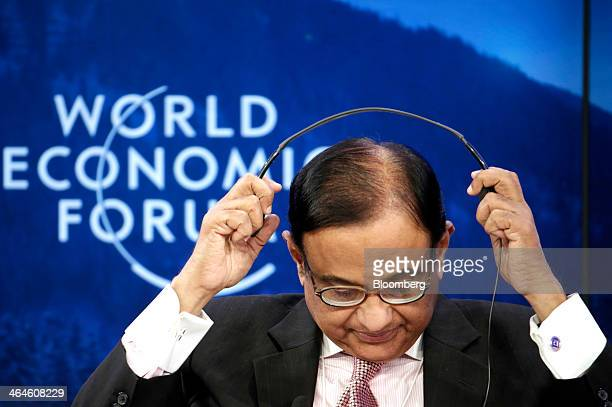 Palaniappan Chidambaram India's finance minister removes his headphones after listening to a speaker during a session on day two of the World...