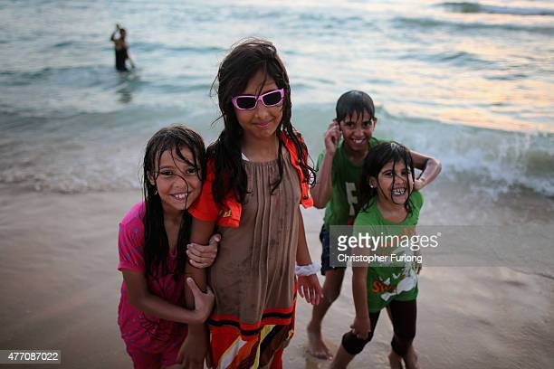 Palastinian children enjoy a dip in the ocean at Gaza beach on June 13 2015 in Gaza City Gaza Palestinians are taking the opportunity to relax and...