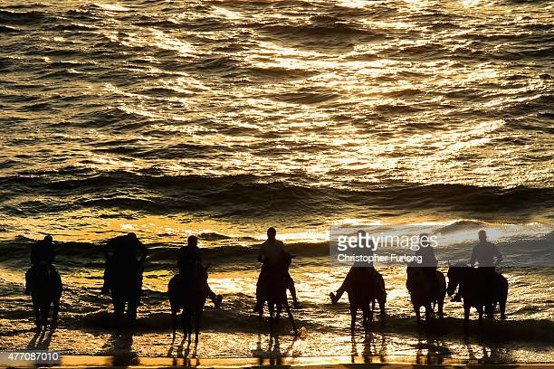 Palastinian men ride their horses in the sea at Gaza beach on June 12 2015 in Gaza City Gaza Palestinians are taking the opportunity to relax and...