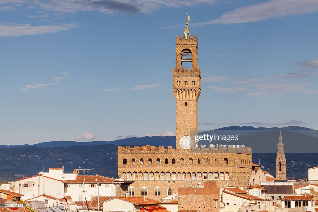 Palazzo Vecchio above the rooftops of Florence : Stock Photo