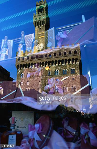 Palazzo Vecchio reflected in shop window, Florence, Tuscany, Italy, Europe