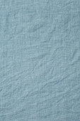 A pale blue cotton tablecloth background