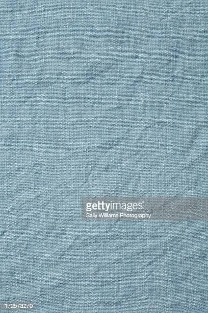 A pale blue cotton tablecloth background