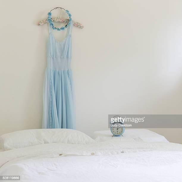 Pale blue nightgown with white linen bed