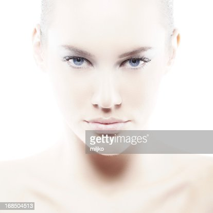 Pale woman with blue eyes on white