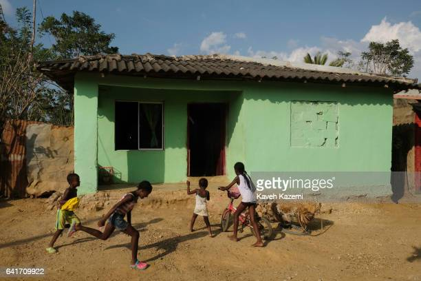 Palenquero children play outside a typical color walled house on January 28 2017 in San Basilio de Palenque Colombia Centuries ago escaped slaves...