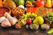 Paleo diet concept. Balanced food background on the table. Copy space, dark background.