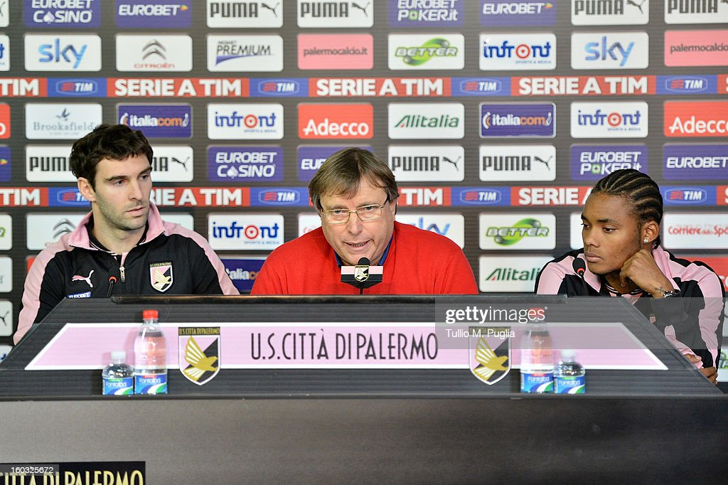 Palermo CEO Pietro Lo Monaco (C) answers questions as Nelson (R) and Mauro Boselli (L) look on during their presentation as new players of Palermo at Tenente Carmelo Onorato Sports Center on January 29, 2013 in Palermo, Italy.