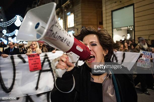 Palermo Dec 20 2013 A girl using a megaphone to lead the demonstration organized to show support and demand better security measures for Di Matteo...