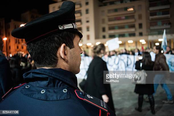 Palermo Dec 20 2013 A policeman looking at the demonstration organized to show support and demand better security measures for Di Matteo People...