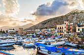PALERMO, ITALY - JUNE 27 2014: Palermo Boat Harbor on a warm summer evening in Sicily, Italy. Lovely Mediterranean Atmosphere