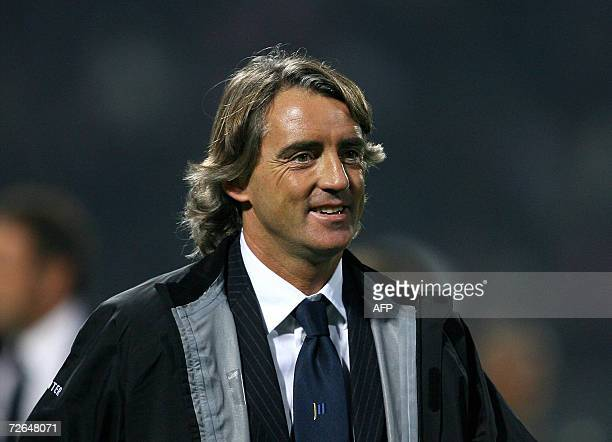 Inter's milan trainer Roberto Mancini smiles after his team won against Palermo during their Italian Serie A football match at Palermo's Barbera...