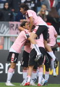 Palermo players celebrate during the Serie A match between Juventus and Palermo at the Stadio Olimpico on October 05 2008 in Tourin Italy