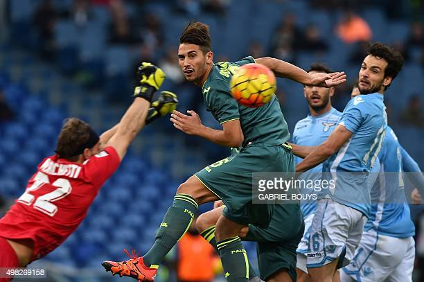 Palermo's defender Edoardo Goldaniga from Italy heads the ball in front of Lazio's goalkeeper from Italy Federico Marchetti during the Italian Serie...